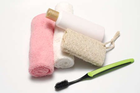 liquid soap: towel loofah liquid soap and toothbrush on a white background