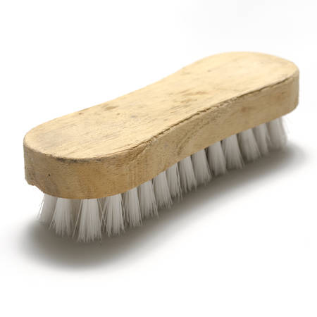 broom handle: dirty wash brush on a white