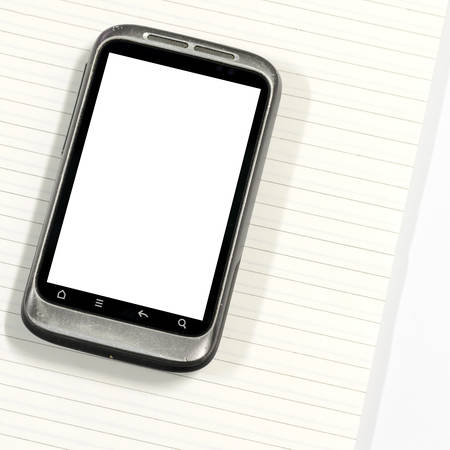 smartphone with note book on a white background Stock Photo