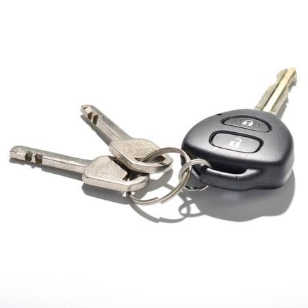 keys and car key isolated on white background