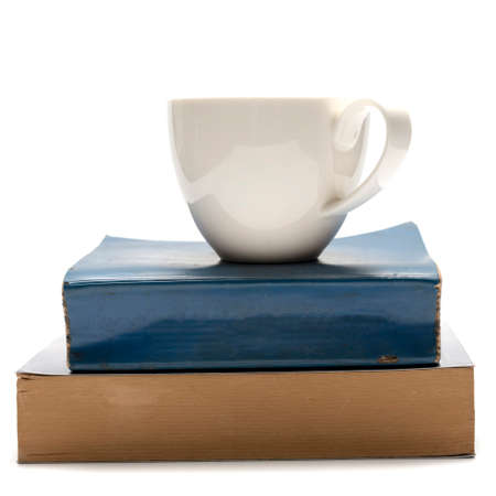 cover background time: stack of book and coffee cup isolated on white background