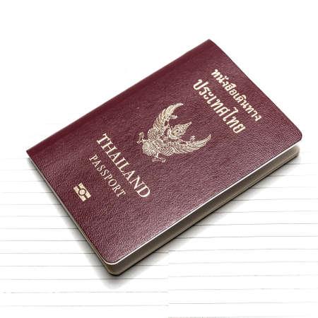 passport on notebook background