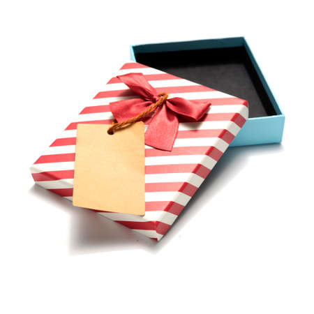 gift box and tag isolated on white background Stock Photo