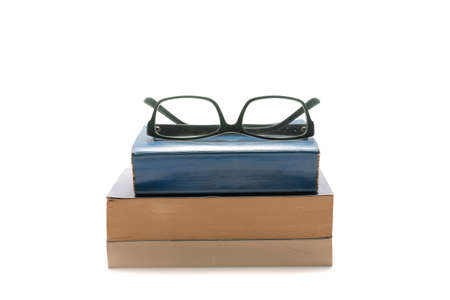 stack of book and glasses isolated on white background