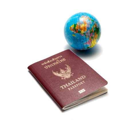 passport and earth ball isolated on white background