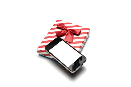 smart phone and gift box isolated on white background