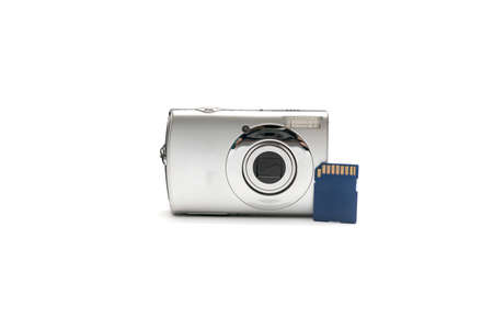 compact camera: compact camera amd sd card isolated on white background