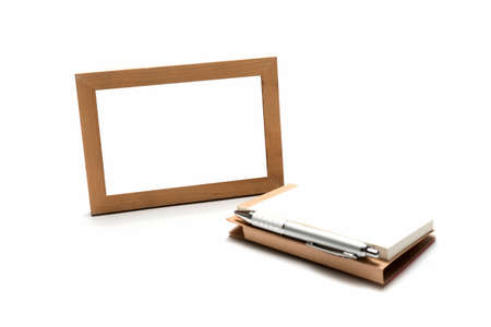 wood photo frame ams notebook with pen isolated on white background photo