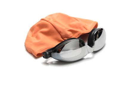 swimming goggles and towel isolated on white background photo