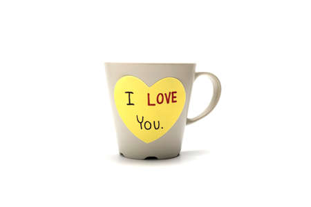 I love you write on heart paper card with coffee mug isolated on white background