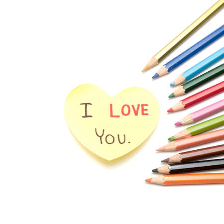 I love you write on heart paper card with color pencil isolated on white background