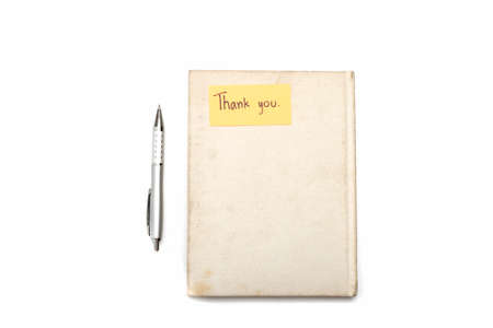 Thank you card on notebook and pen isolated on white background