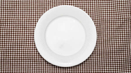 empty dish on kitchen towel background Stock Photo