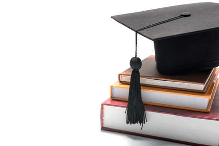 stack: graduation cap and book isolated on white background