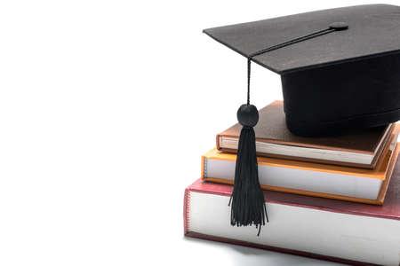 graduation cap en boeken op een witte achtergrond