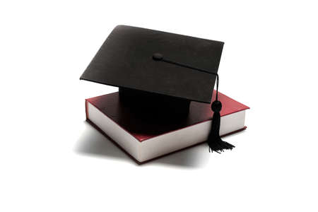 dissertation: graduation cap and book isolated on white background