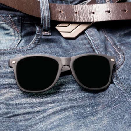 ray ban: sunglasses on jean pants