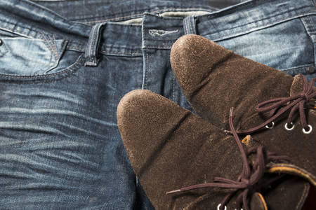 pant: leather shoes on jean pant Stock Photo