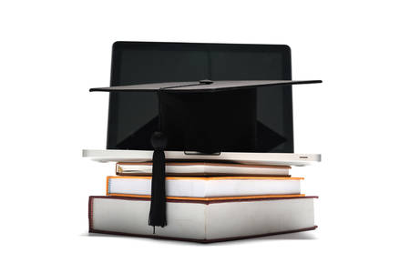graduation cap: graduation cap and book with laptop isolated on white background