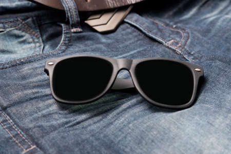 ray ban: sunglasses on jean pants
