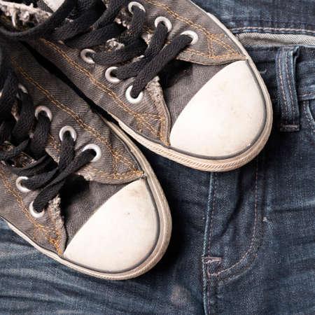 sneakers on jean pants photo