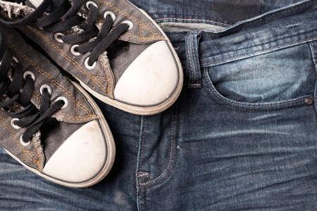 athletic wear: sneakers on jean pants