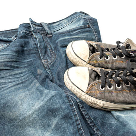 sneakers on jean pants isolated on white background photo