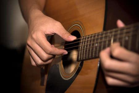 still life man playing guitar close up