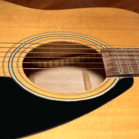 boehm flute: still life close up part of guitar Foto de archivo