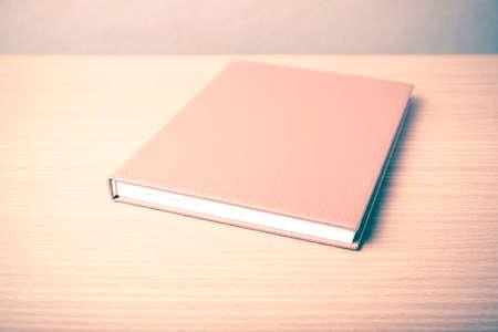 portadas de libros: brown book on wood table background vintage style Foto de archivo
