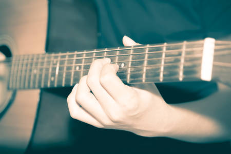 melodies: still life man playing guitar close up vintage style Stock Photo