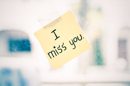 i miss you: I miss you word sticky note on window mirror vintage style Stock Photo