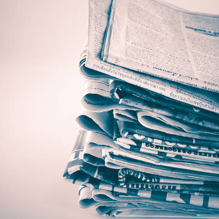 newspaper stack: black and white stack of newspaper vintage style