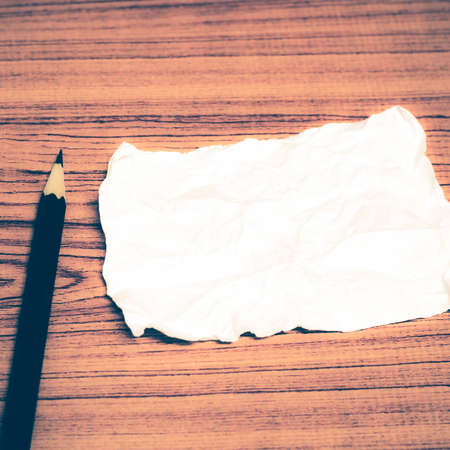 ball lump: paper scrap with pencil on wood background vintage style Stock Photo