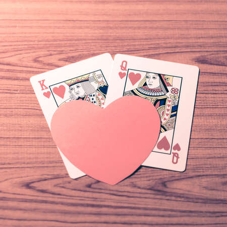 king and queen of hearts: heart and love king queen  card on wood background vintage style Stock Photo
