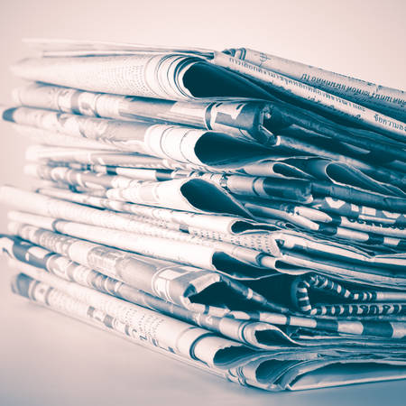 black and white stack of newspaper vintage style
