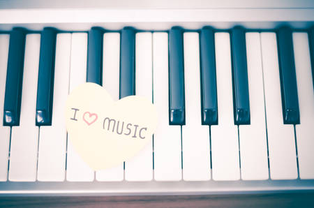 love music: heart on key piano say love music vintage style Stock Photo