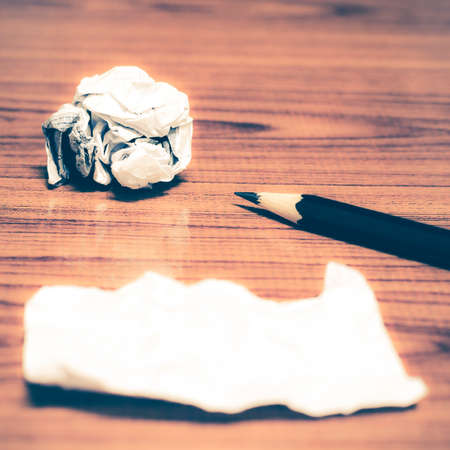 ball lump: paper scrap and crumpled with pencil on wood background vintage style