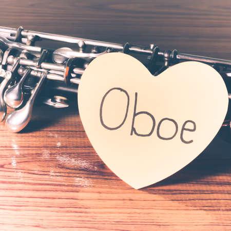 oboe: oboe with heart n wood background