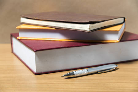 note pad: book and pen on wood background Stock Photo
