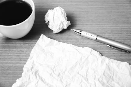 paper and crumpled with pen and coffee cup on wood background black and white color tone style Stock Photo