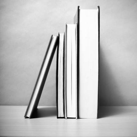 hardcovers: stand up of book on wood table background black and white color tone style