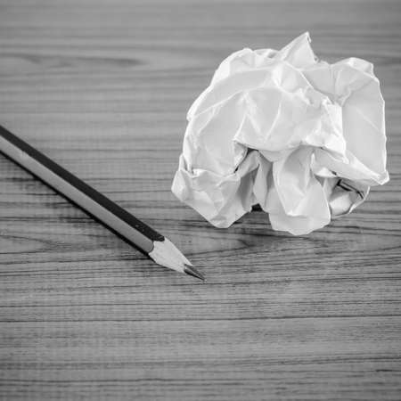 crumpled paper and pencil on wood black and white color tone style Stock Photo