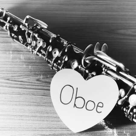 oboe: oboe with heart on wood black and white color tone style