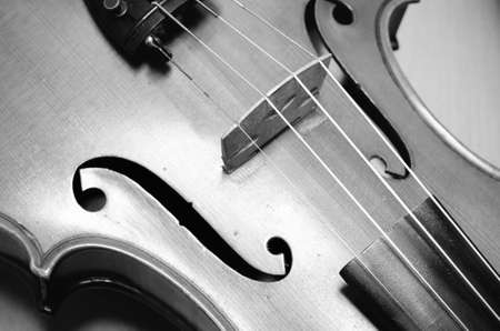 brown wallpaper: single soft brown violin with brown wallpaper black and white color tone style Stock Photo