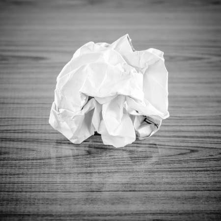 wastrel: crumpled paper on wood black and white color tone style Stock Photo