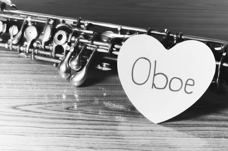 oboe: oboe with heart on wood background black and white color tone style