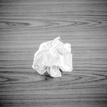 crumpled paper on wood black and white color tone style Stock Photo