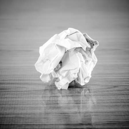 crumpled paper on wood  black and white color tone style