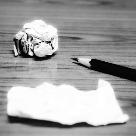 ball lump: paper scrap and crumpled with pencil on wood black and white color tone style